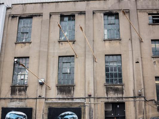 Cupid Arrows in Building. Street Art London England Olympics 2012