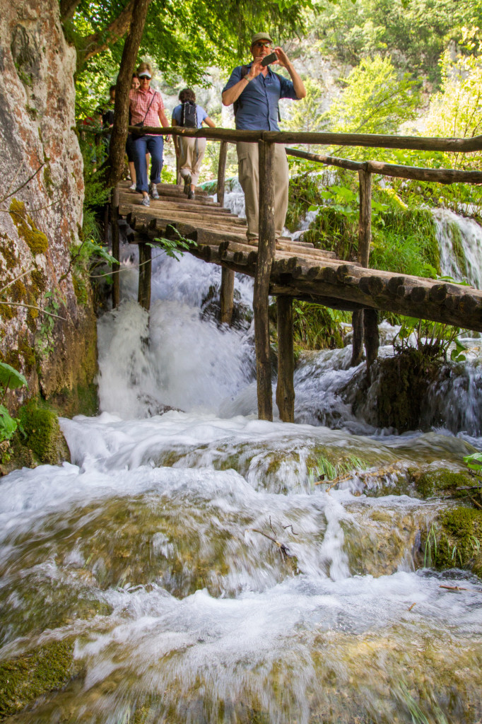 Tourist on walkway at Plitvice Lakes National Park
