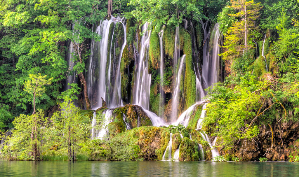 Waterfalls to the mountain and lake in Plitvice Lakes National Parks Croatia