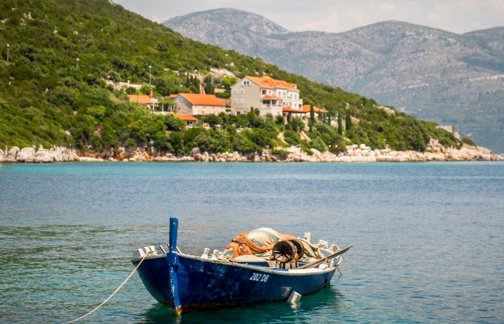 Blue boat in the bay of Sipan Island Croatia
