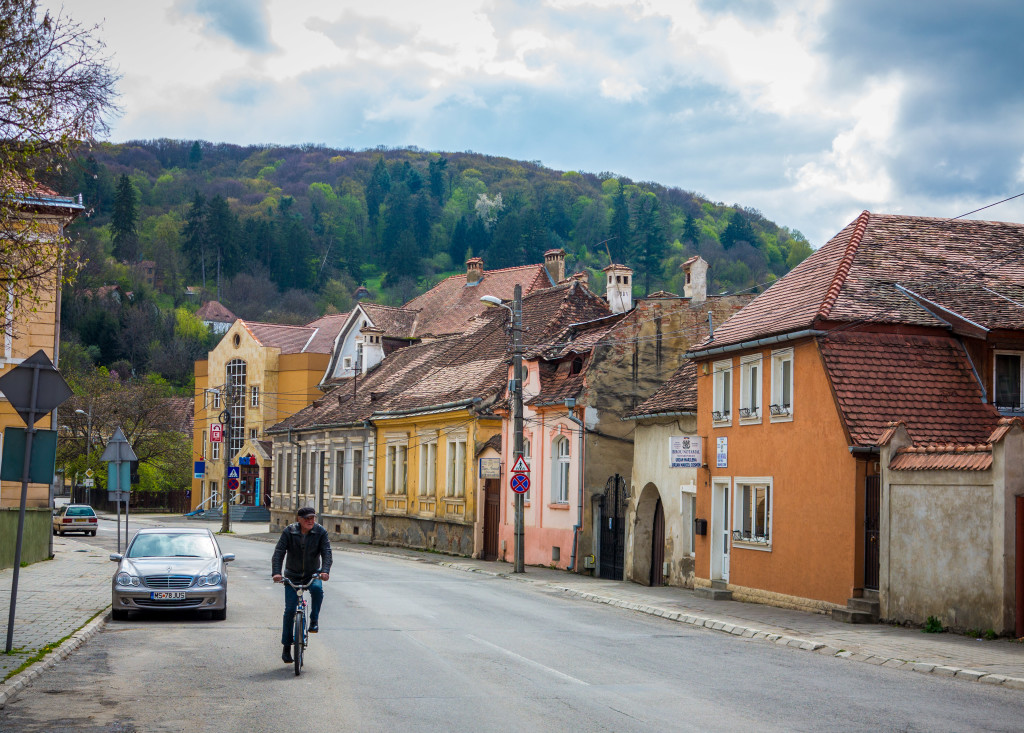 Man Cycling in Sighisoara