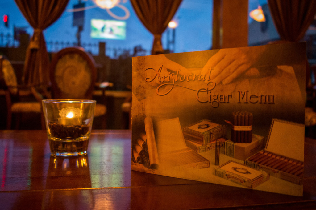Menu and Candle at Aristocrat Cigar Bar and Club in Sighisoara, Romania