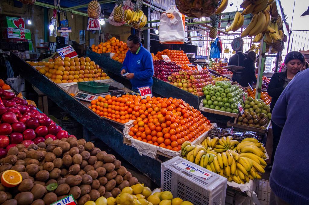 Fruit and Vegetable vendor in La Vega Market. Santiago CHile