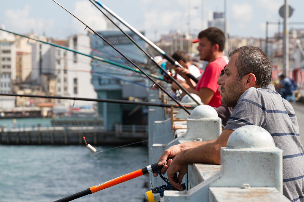 Fishing from Galata Bridge into the Bosphorus