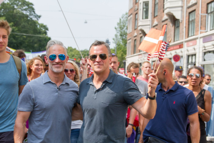 U.S. Ambassador Rufus Gifford and Husband Dr. Stephen DeVincent at Copenhagen Pride marching with the U.S. Embassy