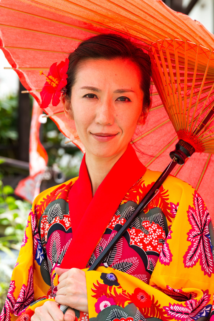 Okinawa woman dressed in traditional Kimono and Umbrella