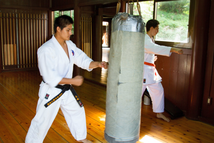 Okinawan and French men practice Karate in Okinawa