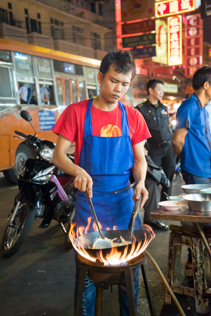 Street Food Vendor in Bangkok. Wok on Fire