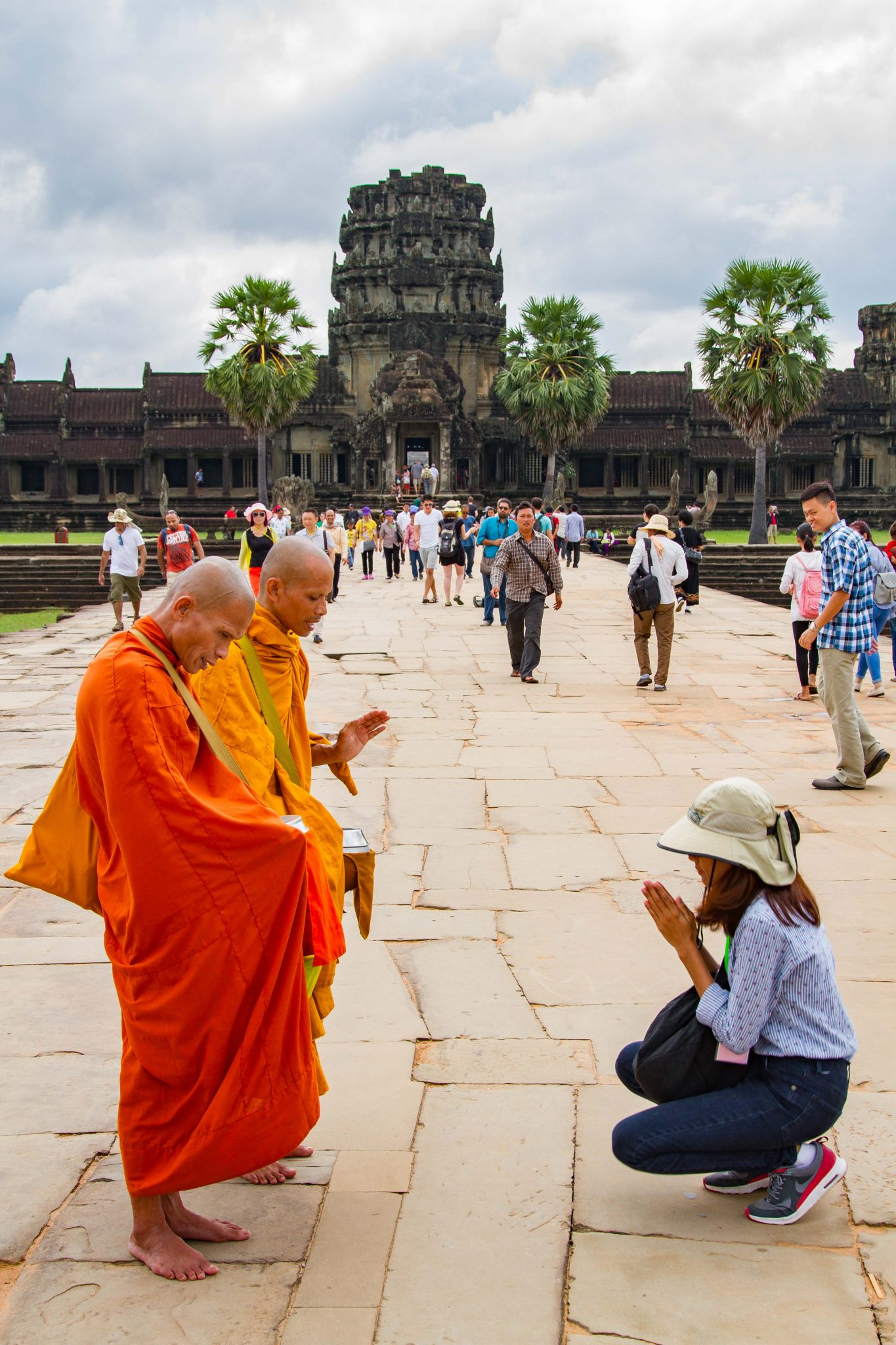 Buddhist Monks Blessing at Angkor Wat Entrance Cambodia