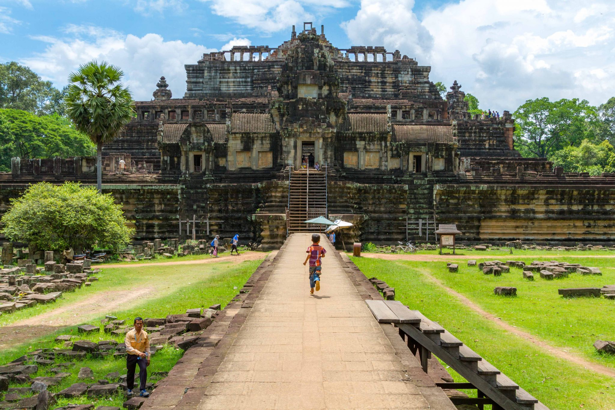 Child running to Baphuon Temple Angkor Wat