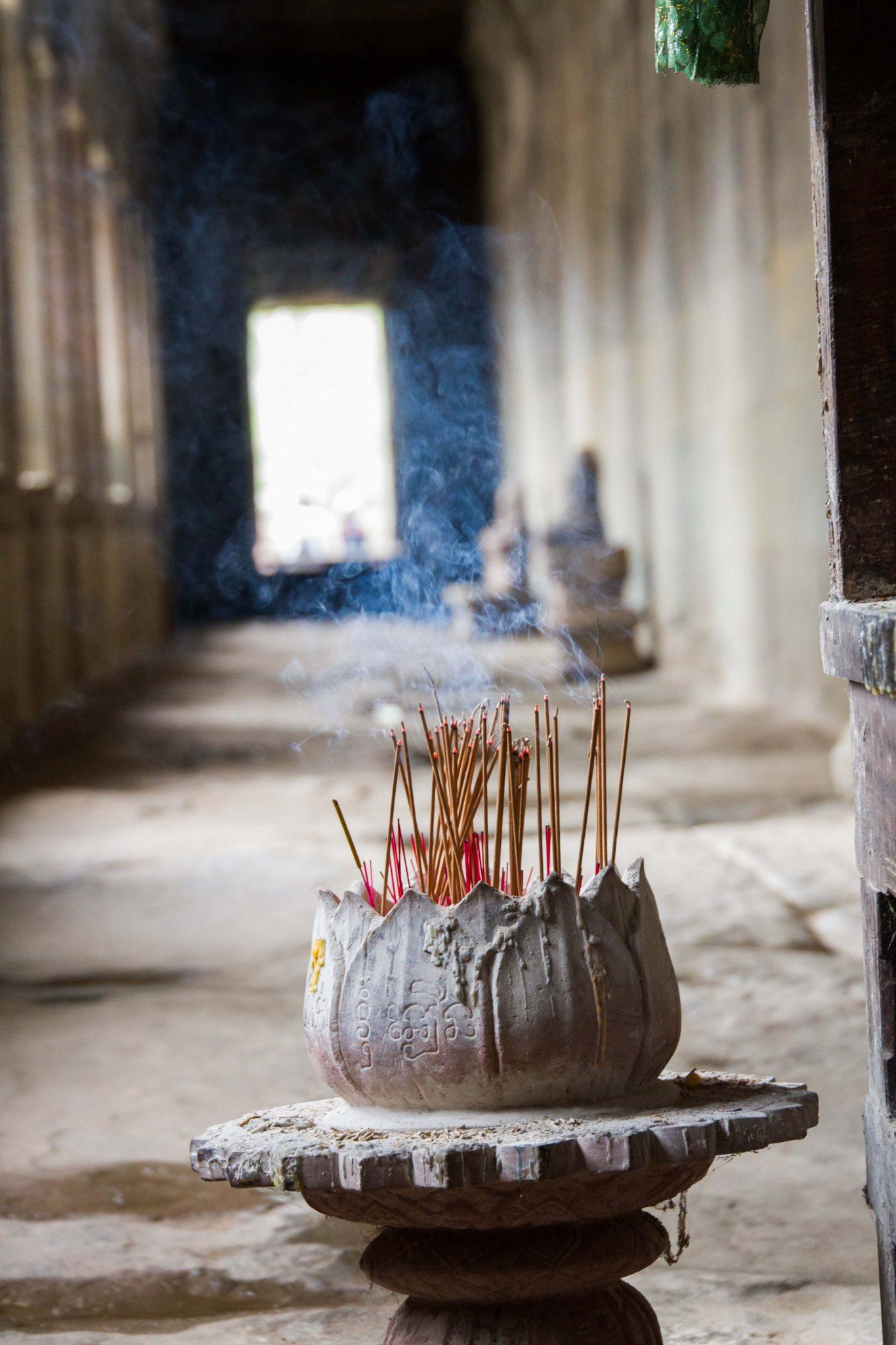 Incense Burning Prayer at Angkor Wat Cambodia