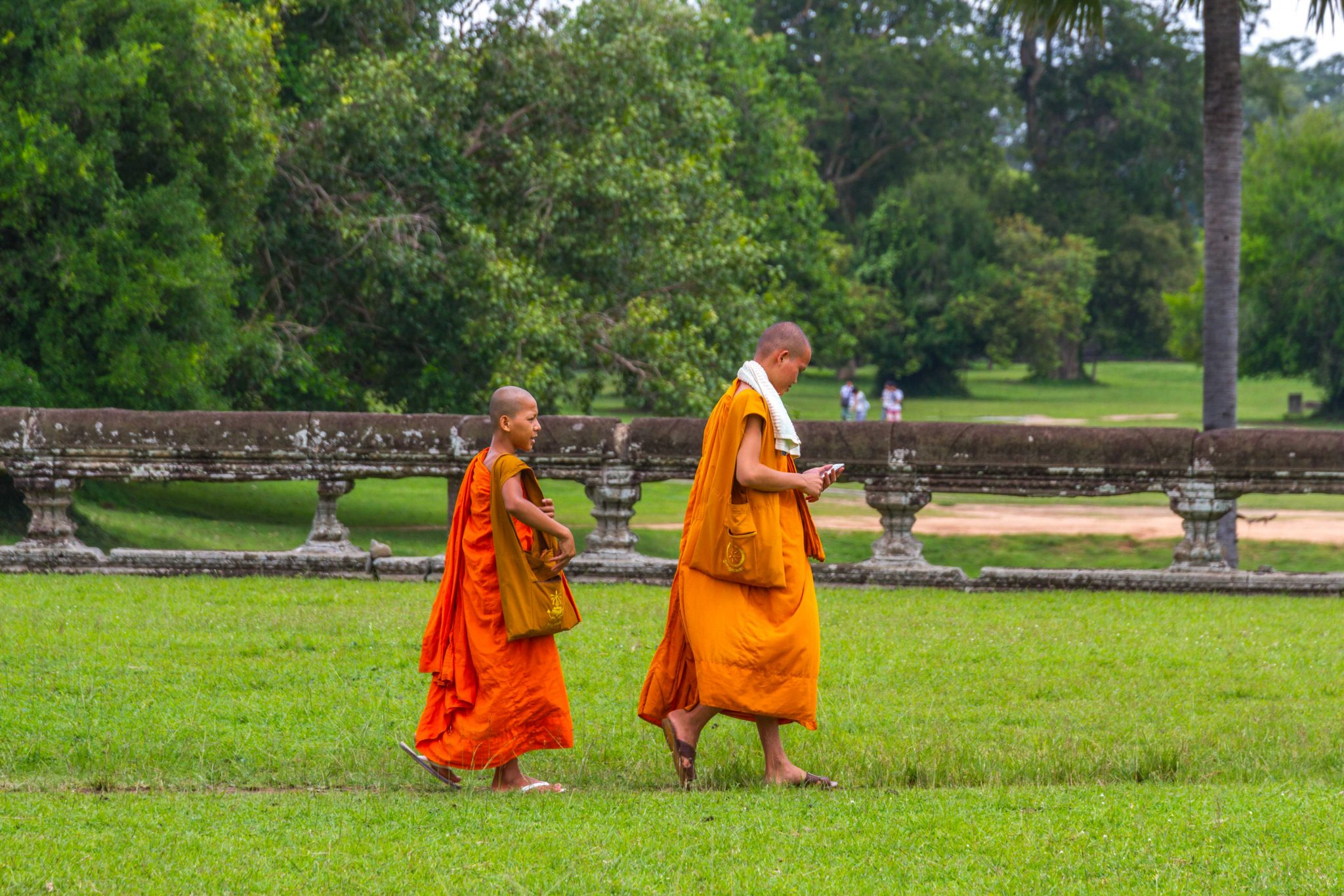Young Buddhist Monks with Phone at Angkor Wat Cambodia