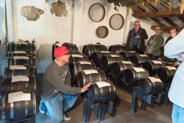 Italian Days Food Tour guide explains a Balsamic Vinegar DOP batteria