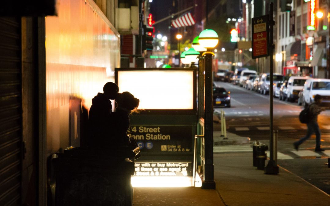 Couple Kissing at Penn Station Train Station in New York City